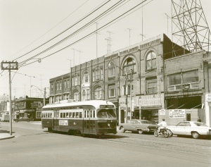 1-178: TTC PCC streetcar 4328 Dundas St. W. at McMurray Ave. looking west, 3030-3038 Dundas W. buildings, hoardings at Bad Boy store, photographer John Thompson source John Thompson 'date acquired' August 1999